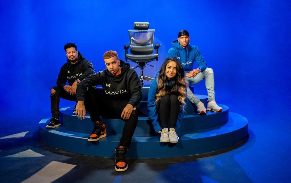 Mavix ambassadors pose with the Mavix chair.