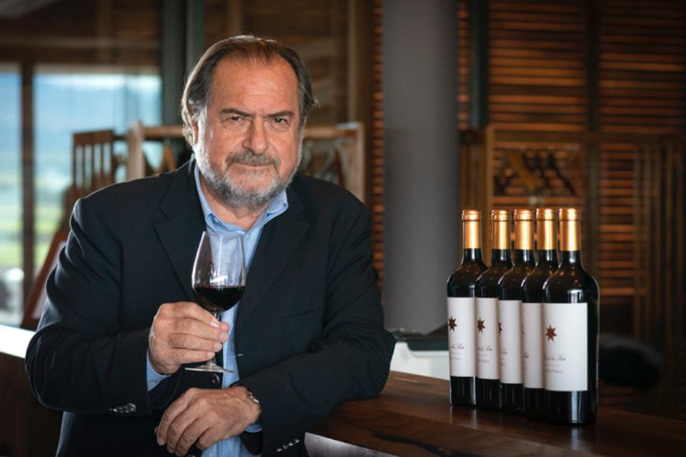 Winemaker Michel Rolland with a glass of Clos de los Siete