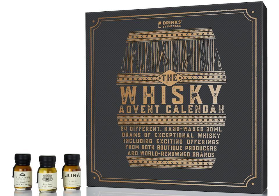 small bottles of whisky beside a calendar