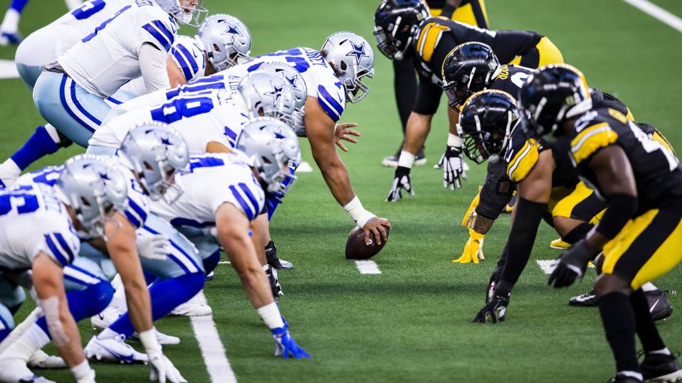 The Dallas Cowboys offense lines up against the Pittsburgh Steelers defense.