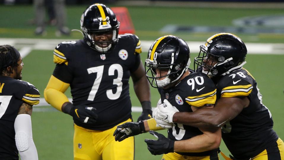 Pittsburgh Steelers' Carlos Davis #73, T.J. Watt #90, and Vince Williams, right, celebrate