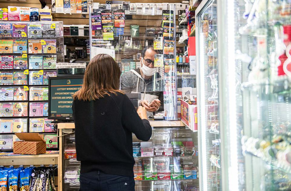 A woman buying something at a bodega in New York