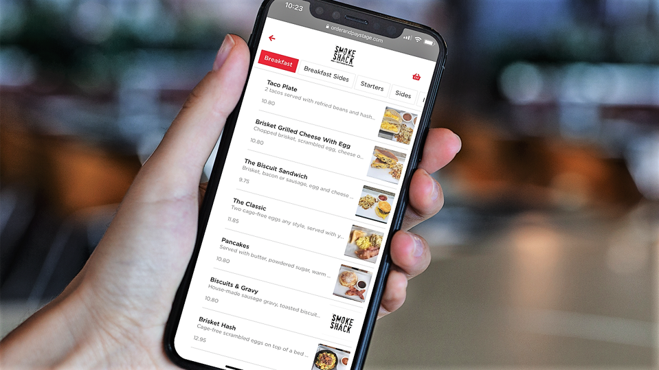 Smartphone showing food menu at an airport restaurant.