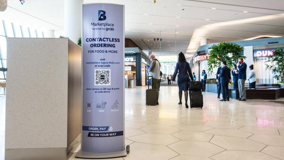Contactless ordering ad out at LaGuardia Airport.