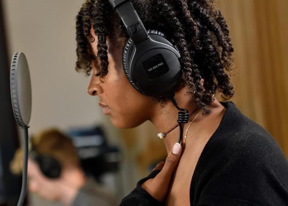 Vocalist wearing Sennheiser HD300 Pro