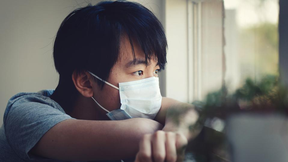 Young Asian boy in home quarantine