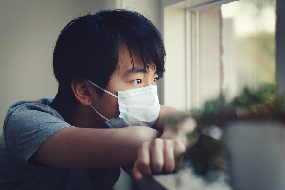 Young boy in home quarantine