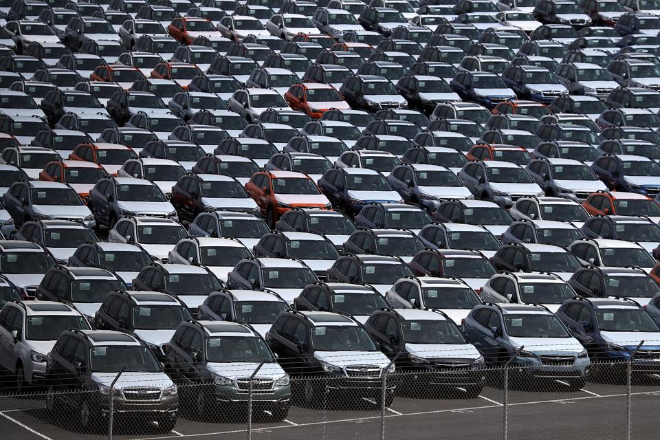 New cars, wrapped for shipping and stored near the Port of Richmond, Calif.