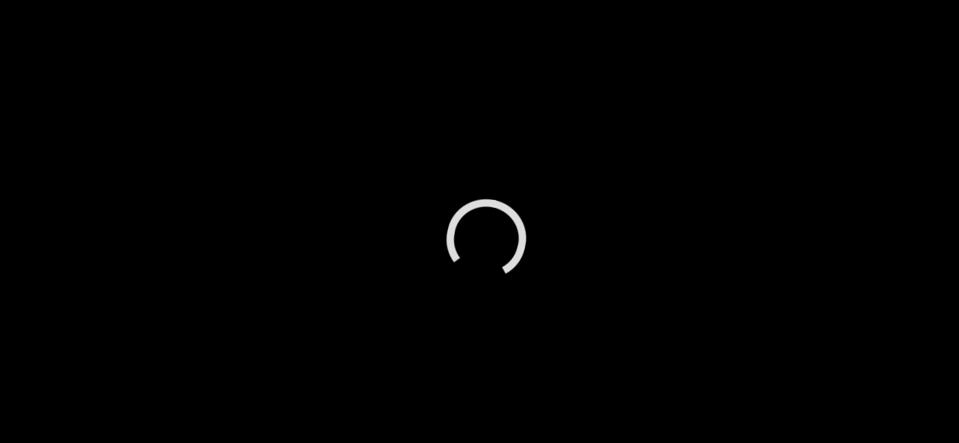 Black screen and white loading circle.