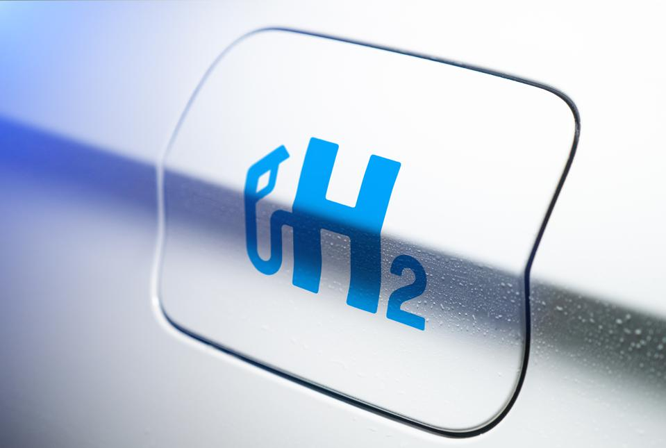 Car with hydrogen logo on filler cap. h2 combustion engine for emission free ecofriendly transport.