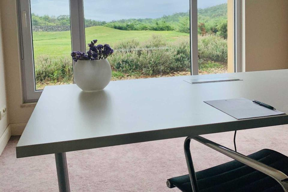 A desk sits in front of a window at Penha Longa Resort in Sintra, Portugal