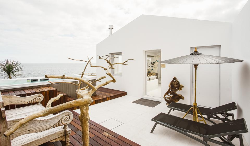 The Villa at White in Portugal has a private hot tub overlooking the Atlantic Ocean.