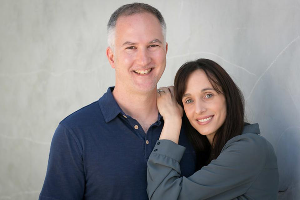 Stephanie Canale, M.D. founder of Lactation Lab stands next to her husband, Eric Canale, MBA.