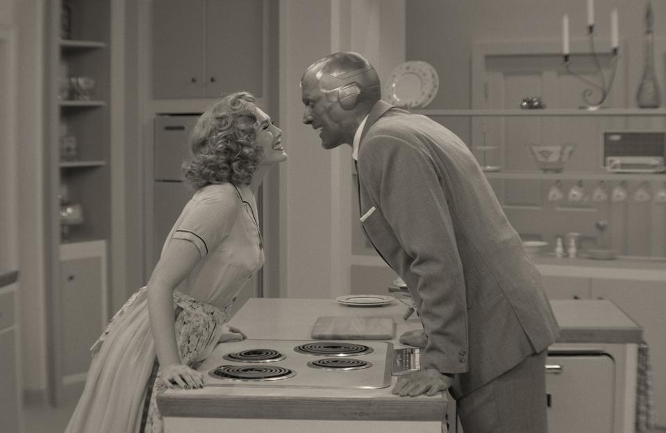 Wanda Maximoff and Vision in a 50s-style kitchen.