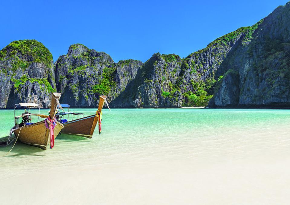 Maya Bay beach with two longtail boats, Ko Phi Phi Leh Island, Thailand