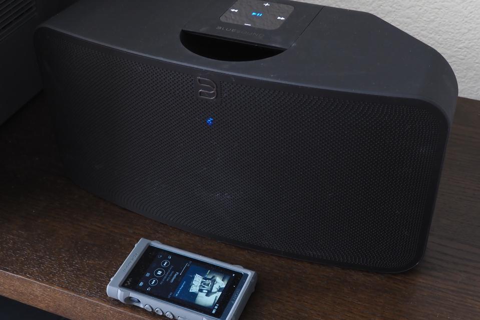 The BlueSound Mini 2i on a shelf with Sony music player