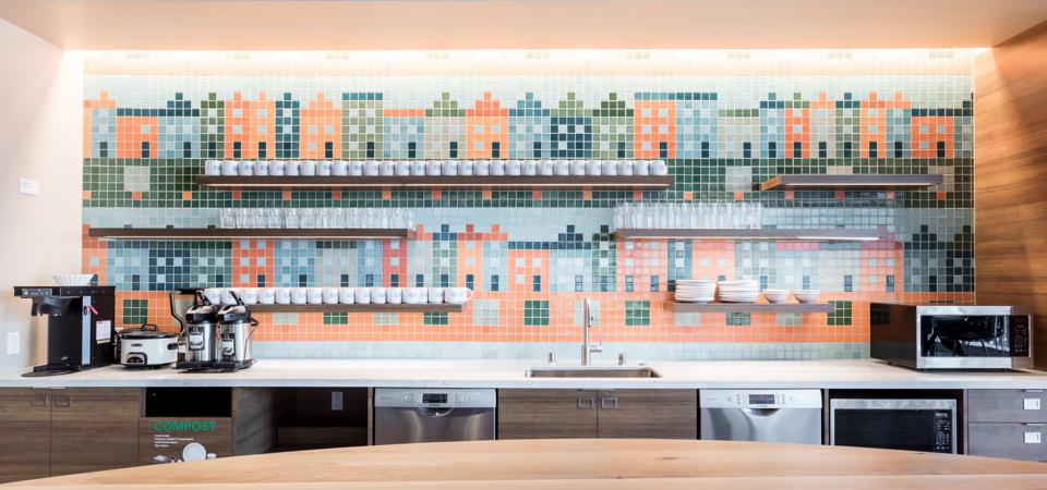 Fireclay Tile installation of 2x2 tiles in a rainbow of colors at Salesforce East in San Francisco