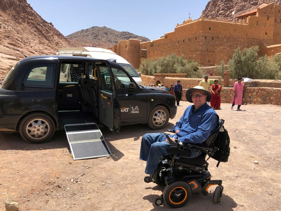John Morris in front of black cab in Sinai, Egypt