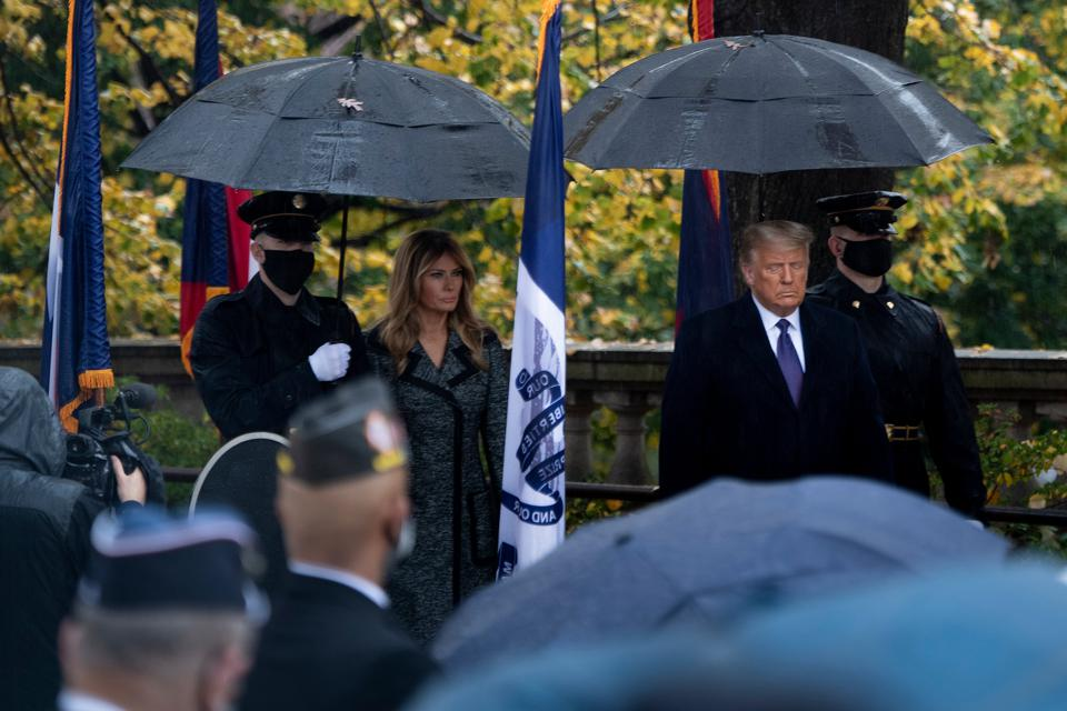 US First Lady Melania Trump and President Donald Trump arrive for a wreath laying ceremony at the Tomb of the Unknown Soldier for Veterans Day at Arlington National Cemetery in Arlington, Virginia, on November 11, 2020.