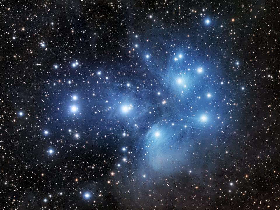 The nebulosity between the stars of the Pleiades can be seen in a long exposure photograph.