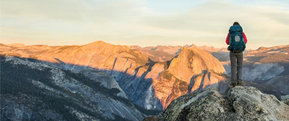A hiker stares at the vista in one of America's National Parks.