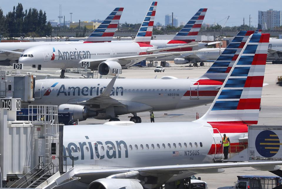 American Airlines aircraft are parked at gates at MIA