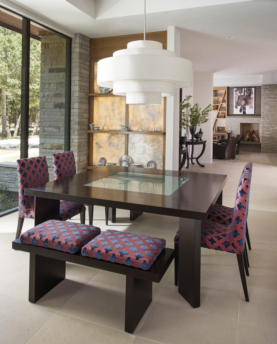 A modern dining room by Denise McGaha