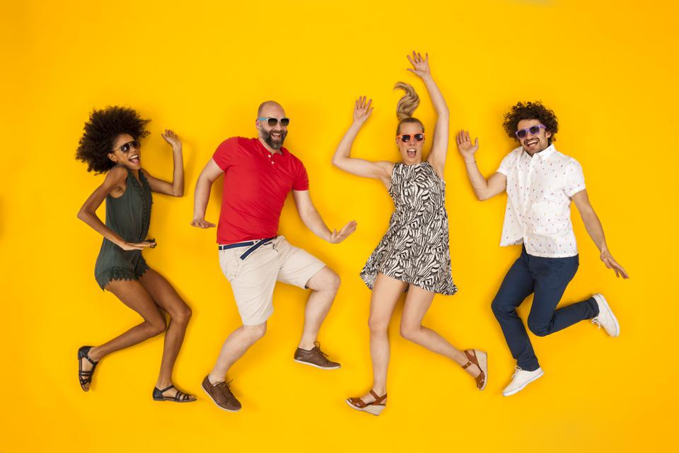 Group of people wearing sunglasses, dancing happily