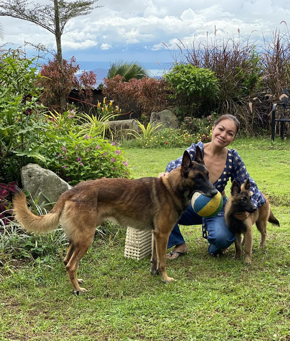 This author with her two dogs: a three year old Belgian Malinois named Whisky and a Belgian Tervuren puppy named Coco.