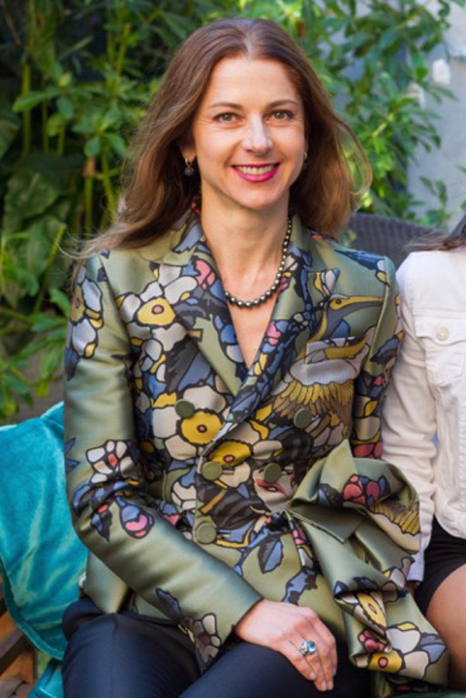 Founder and CEO of BSPK Zornitza Stefanova in  grean floral jacket and navy pants