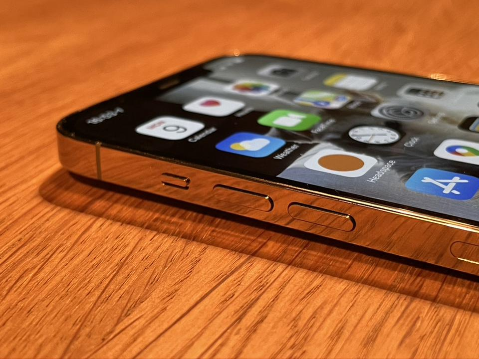 Apple iPhone 12 Pro Max in gleaming gold finish.