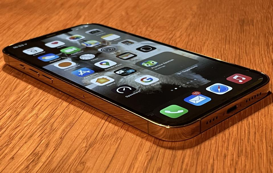 Apple iPhone 12 Pro Max, gold finish gleaming.