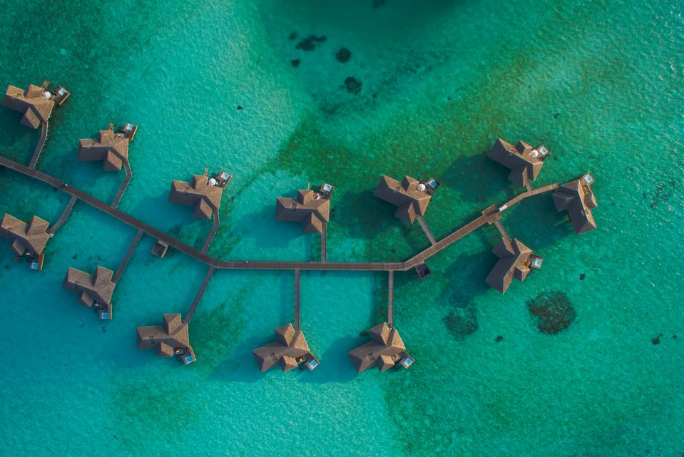 Aerial view of pier houses in the Maldives.