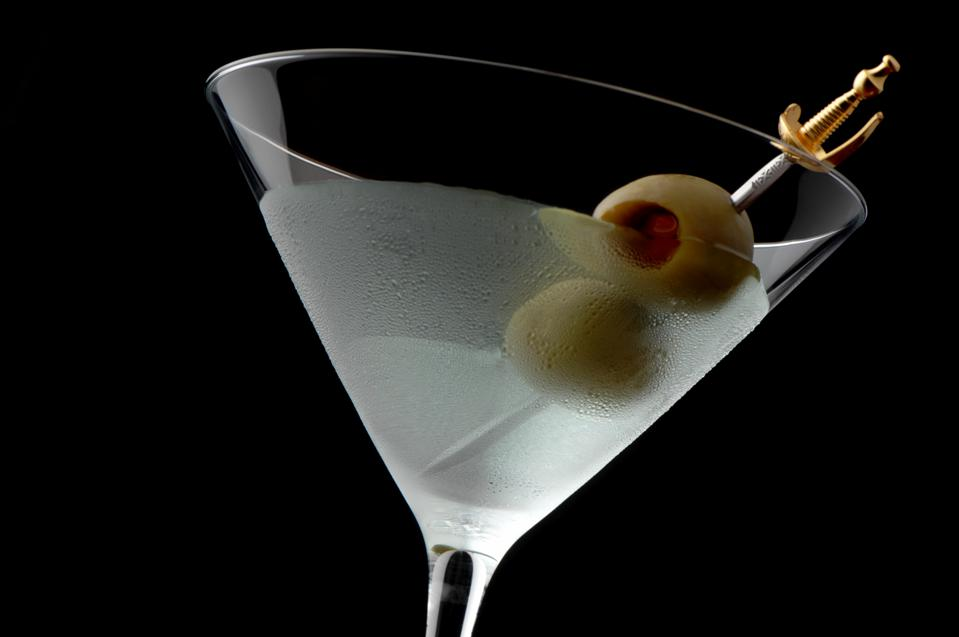 Martini Cocktail with Olives on Black