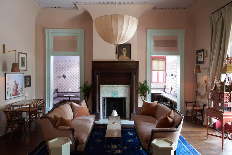 A traditional living room with an inverted dome chandelier