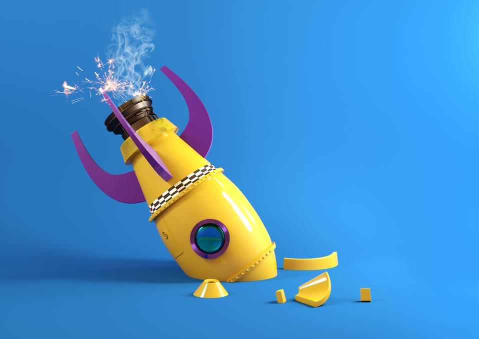 Crashing Retro Toy Rocket symbolizes startup failure