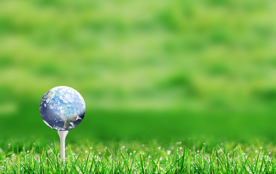 Eco-friendly Golf Course With Ball in the Shape of Planet Earth on Tee