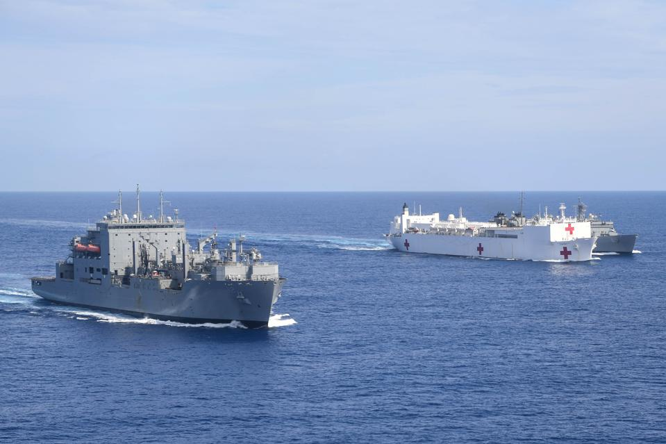 1 Oct 2020:  The U.S. Military Sealift Command hospital ship USNS Comfort is underway to support humanitarian relief operations in Puerto Rico, along with dry cargo ship USNS William McLean, right.