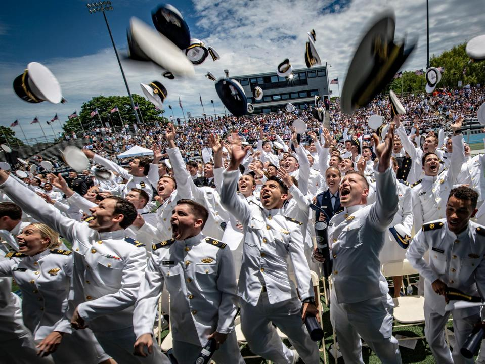 The United States Merchant Marine Academy in Kings Point, New York on Saturday, June 15, 2019. Graduates toss their hats during the 83rd Commencement Exercises.