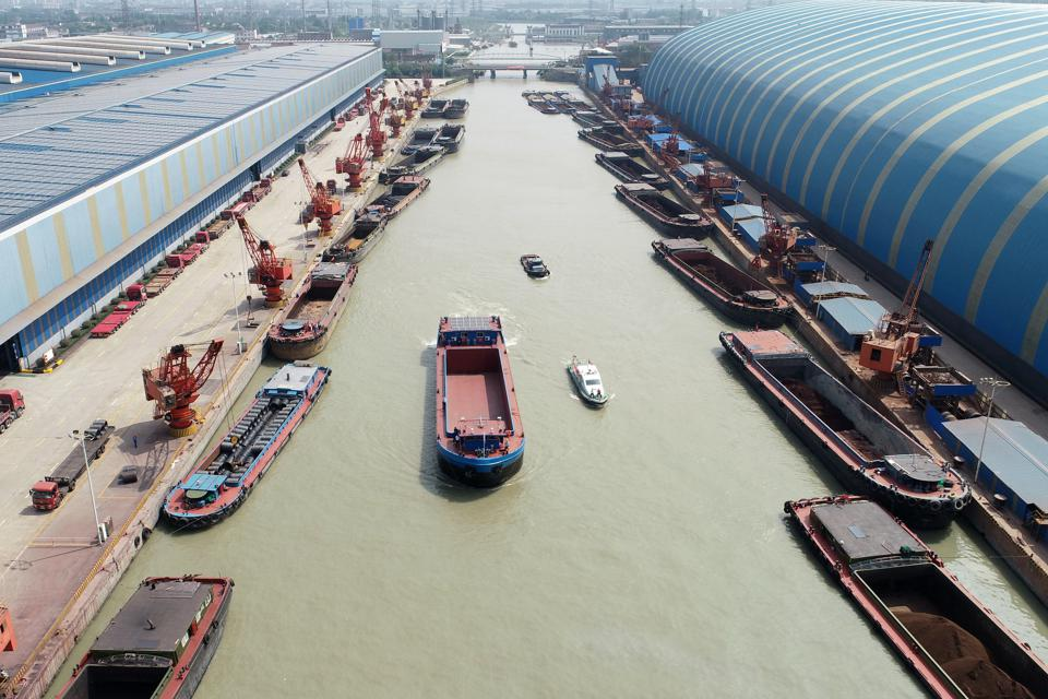 7 May 2020: Electric cargo ships tested in the dock, Changzhou, Jiangsu Province, China, showing how far other countries have overtaken U.S. leadership in green maritime transportation.
