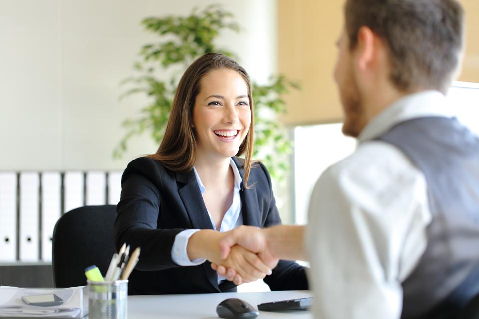 Businesspeople handshaking after deal or interview
