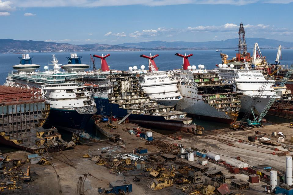 2 Oct 2020: Shipping is one of the biggest drivers of carbon emissions.  Seen here: Luxury cruise ships are seen being broken down for scrap metal at the Aliaga ship recycling port in Turkey.