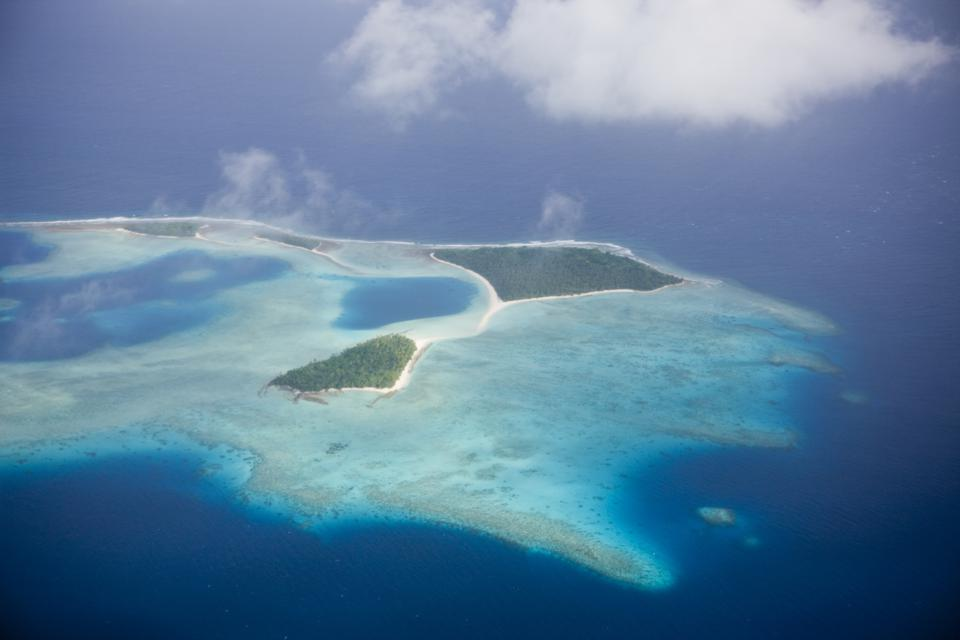 Low lying Marshall Islands have been calling for more urgent action on climate change to avoid sea level rises that threaten their nation. Aerial View of Marshall Islands, Ailinglaplap Atoll, Micronesia, Pacific Ocean