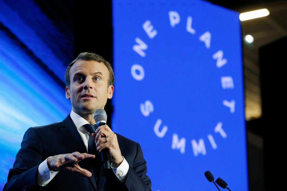 French President Emmanuel Macron delivers a speech during the 'Tech for Planet' event at the 'Station F' start-up campus ahead of the One Planet Summit in Paris on December 11, 2017.