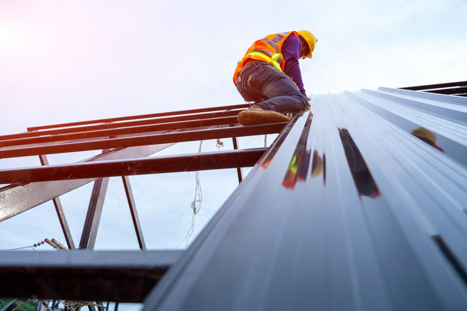 Roofer worker in special protective workwear
