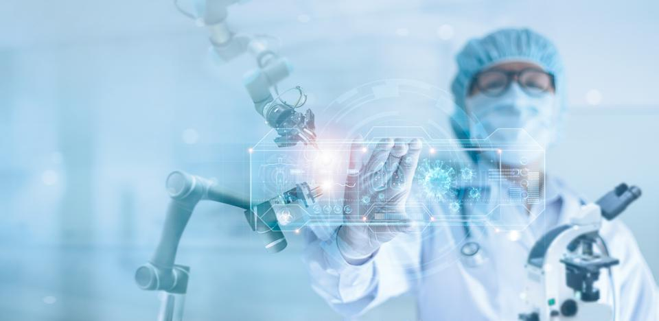 Medicine doctor and robotics research and analysis, Scientist diagnose checking coronavirus or covid-19 testing result with modern virtual screen in laboratory,  Medical technology and inhibition of disease outbreaks.