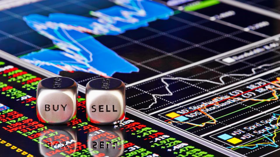 Close-up of a buy and sell roll of dice over trader's chart