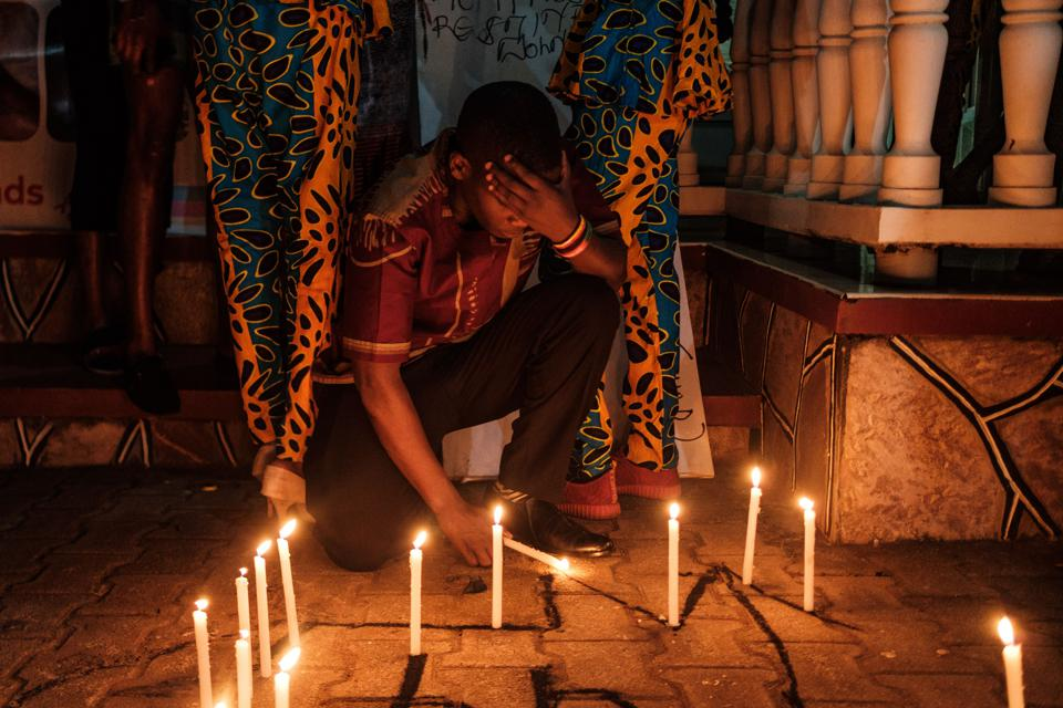 UGANDA-LGBT-SOCIETY light candles in a vigil for last year's Trans Day of Remembrance