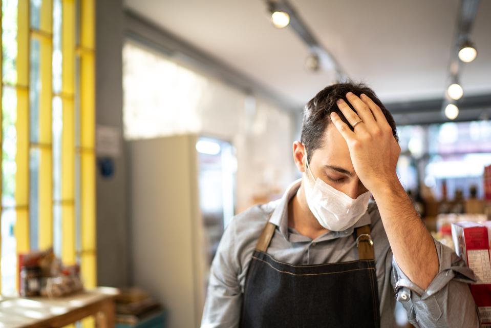 Face mask wearing cafe owner