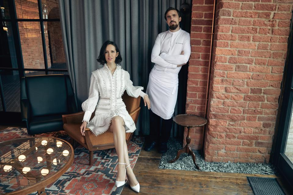 The restaurateur and chef pose in a lounge at a restaurant in St. Petersburg, Russia
